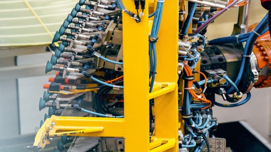 Largely automated production of glass fiber-based composite leaf springs at the component facility of SGL Carbon in Innkreis, Austria.