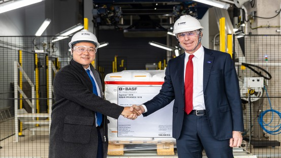 During the opening ceremony for the second phase of BASF's new, world-scale antioxidants plant in Shanghai, China, Mr. Daniel Wang (left), Procurement Manager of Borouge, receives the first pallet of Irganox® 1076 from Hermann Althoff, Senior Vice President, Performance Chemicals Asia Pacific, BASF.