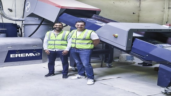 Keiran Smith and Karim Debabe in front of the brand new INTAREMA® 1108 TVEplus® RegrindPro® made by EREMA. The machine processes up to 500 kg/h of HDPE and up to 600 kg/h of PP plastic from household waste to produce recycled pellets.