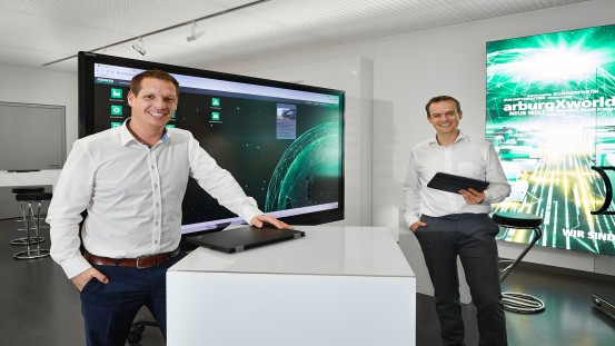 Arburg digitalisation experts: Benjamin Franz (left), Manager Digital Solutions, and Stephan Reich, Department Manager IT Applications Development.